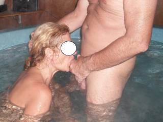 Sucking his lovely hard cock in the new spa house at home.  I can see we are going to have a lot more fun there in the future.