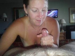 I really like her expression as she grabs your cock.  Nice smile as she is about to suck on you.  Reminds me of my wife.  She still loves, after all these years to make over me and watch her favorite toy grow and puts it to good use.  By the way welcome to zoig.  You are welcome to check out our photos.