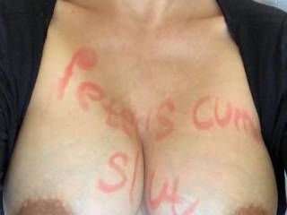 My wife met a guy online and he demanded she take a picture of her tits with his name scrawled all over them.  She was happy to oblige him like the slut she is.  What would you make her write?