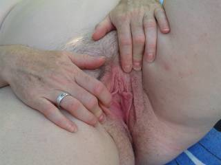 I'm a little bit excited, trying to finger my pussy outdoors