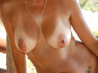 Don't you mean looking hot in the sun? Perfect tits! Very sexy woman!