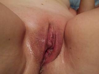 My wife's pussy after being hammered by her huge dildo.  So wet and worn out.
