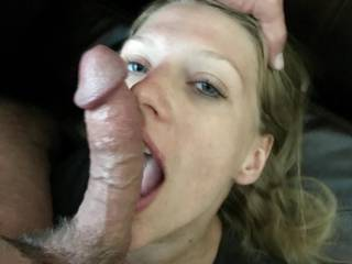 Kneeling and taking care of her Master's cock like a good little slut.