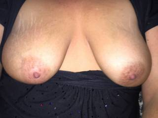 This is my wife's sexy tits in the car before we go into the XXX video store :)