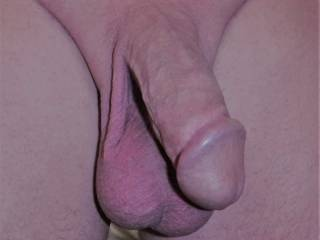 His lovely thick smooth cut cock and big low hanging balls. I just love the look of it soft or hard.