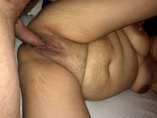 His big cock slides easily in her wet pussy