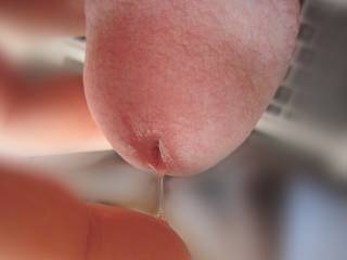 Ummmmmm......All I can say is Ummmmmm.......Yummy.......  With just the very, very tip of my tongue I want to lick that yummy precum off the tip of your gorgeous cock head........