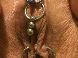 Just a super close shot of her new jewelry. I absolutely love her pussy. What do you think? If anyone knows of any cool jewelry for your pussy send me a picture let me know we\'re always looking for awesome new stuff.