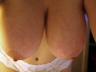 I would love to lick, suck, nibble, massage, fuck and cover those incredible breasts with my hot cum..
