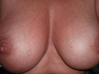 Her natural 38d tits, lovely shape and size.  What do you think?  I love to see hot cum over them.