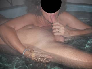 Steamy fun in our spa, with our swinger friend, when he came around for a threesome.