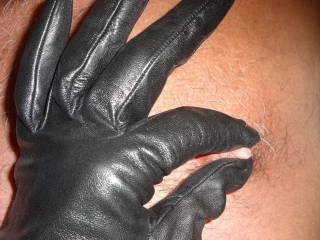 We like to play games - so she did a little nipple play while wearing her leather gloves