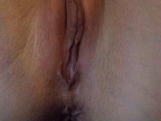 Beautifully smooth and delicious looking pussy. All it's missing is a coating of my saliva and a filling of cum :-)