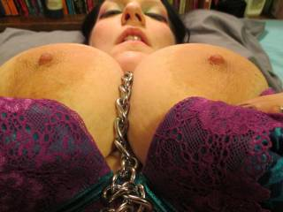 Of course I will take your leash as I suck those big, beautiful nipples as I squeeze those huge gorgeous tits. Oh the end seems to be stuck between your legs, well I better lick down there so it will cum loose.