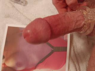 Stroking my cock until my cum pools on her tits.