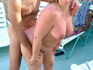 Goofing around by the pool at out local swinger\'s resort.
