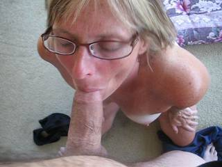 Holiday repost from a few years ago. Wife giving a blowjob in the sunroom on a summer day.