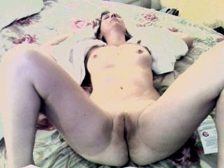 Here\'s Connie spread out on the bed after the shower. What do you all think?