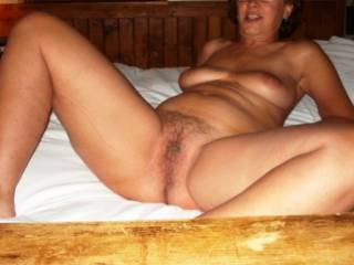 Older pic with the wife showing off.  From the days before she shaved. Think she just put down her vib and wants some action.