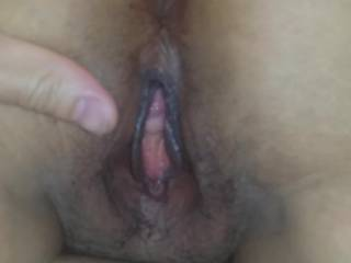 Open up her pussy and ass. Ready for licking and fucking.