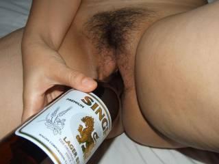 pretty vagina eats a bottle ,