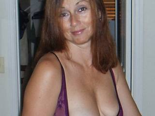 Sweetie wanna pose for me and let those beautiful breasts hang out.  I'd love it.  I'll even hold them for you. :)   G