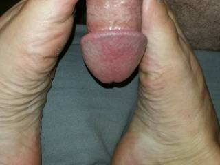 Getting him ready with my toes. Love feeling hard cock on my feet, and warm cum too!