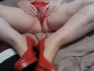 "I love to spread my legs with my red ""fuck me pumps"", and showing off my soaking wet  pussy that needs a man's hard, thick, and juicy cock inside of it!"
