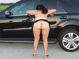Ass and pussy on display by the roadside.