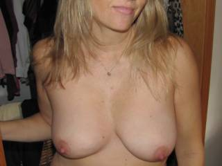 Your natural tits are beautiful!! Personally, I don't like fake tits. Sure they look great but they don't ride great and they just don't feel natural. Plus, you run the risk of losing the sensation in your nipples and they are too delicious for that!!