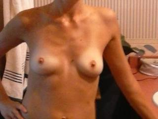 Love those little titties would love to strip you down the rest of the way and lick that pussy of yours get you nice and wet
