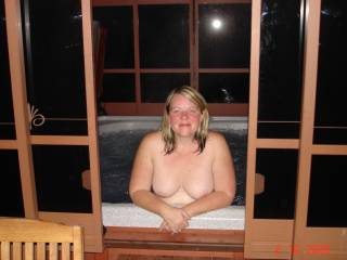 my wife nude outdoors in our hot tub