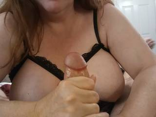 Ever grabbed a hard, thick cock? I love squeezing it for that wonderful cum I dearly love. Watch both of my videos as I take care of hubby\'s wonderful cock, and make sure you see him explode all over my hands like a volcano.