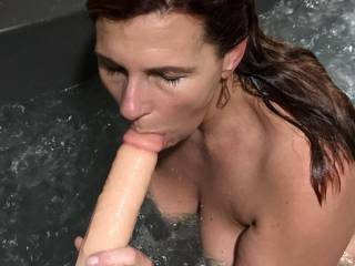 Sucking on dildo