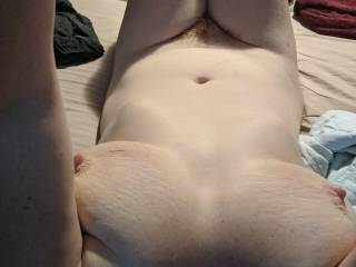 Would somebody please open up my legs and get inside my hairy wet pussy?