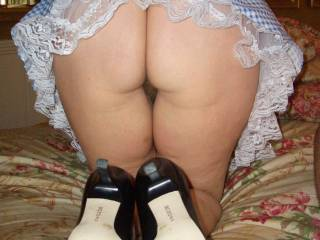 ohhh what a sexy view I would love to raise your skirt to take in the view of your beautiful ass, squeezing those sexy cheeks as I slip my cock into your hot hairy pussy mmmmm