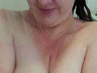 Admiring her huge milk filled lactating breasts and the wonderful cleavage they make!