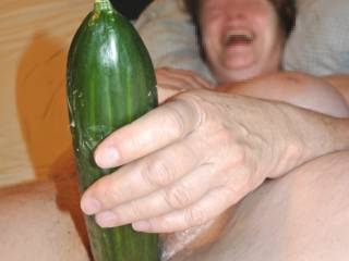 Beautybird enjoying a huge cucumber! Can you tell by her smile?