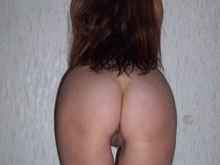 Absolutely beautiful ass! And your pussy peeking out makes my big thick cock sooooooo fucking hard! I want to stick my nose between your sweet cheeks and lick your delicious pussy and suck your erect clit right where you stand! Right against the wall!