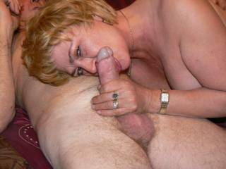 wife takes a mouthfull of friends cock for the camera