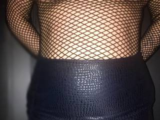 My slutty easy wife in Fishnet dress and short skirt .