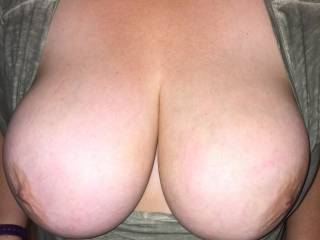 Surprising hubby with a tit shot during the day.