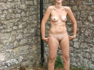 completely naked in public,theres a public carpark just behind the wall