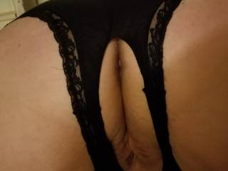 Taking some poses and showing her sexy ass in her crotchless panties. She loves teasing me with her ass in the air. She gets so wet knowing you\'re all going to be looking too.