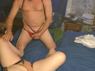 Watching her play with herself wearing a leather harness I made for her was getting me so hot I just had to start rubbing my cock through the thong she made for me.
