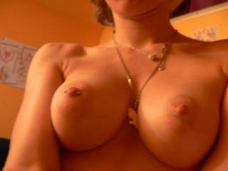 your tits are perfect... all 8 inches of my cock are throbbing right now in my hand as i look at this picture ;) cant wait to see more from you sexy!