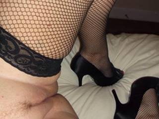 HEELS... STOCKINGS... SHAVED PUSSY... I am on my way to take you.. open your legs a little WIDER and then i want to kiss it first
