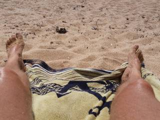 On the nudist beach hanging out...
