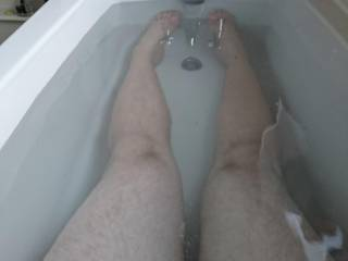 Legs for days in my friends massive bathtub. Small dick standing proud (well, trying)