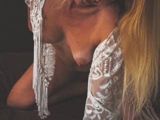Down blouse shots are one of my favorite scene to shoot. I love to capture the beauty of a woman breast in fashion. Although I can\'t show her full body, the expression of her face on this image is out of this world.